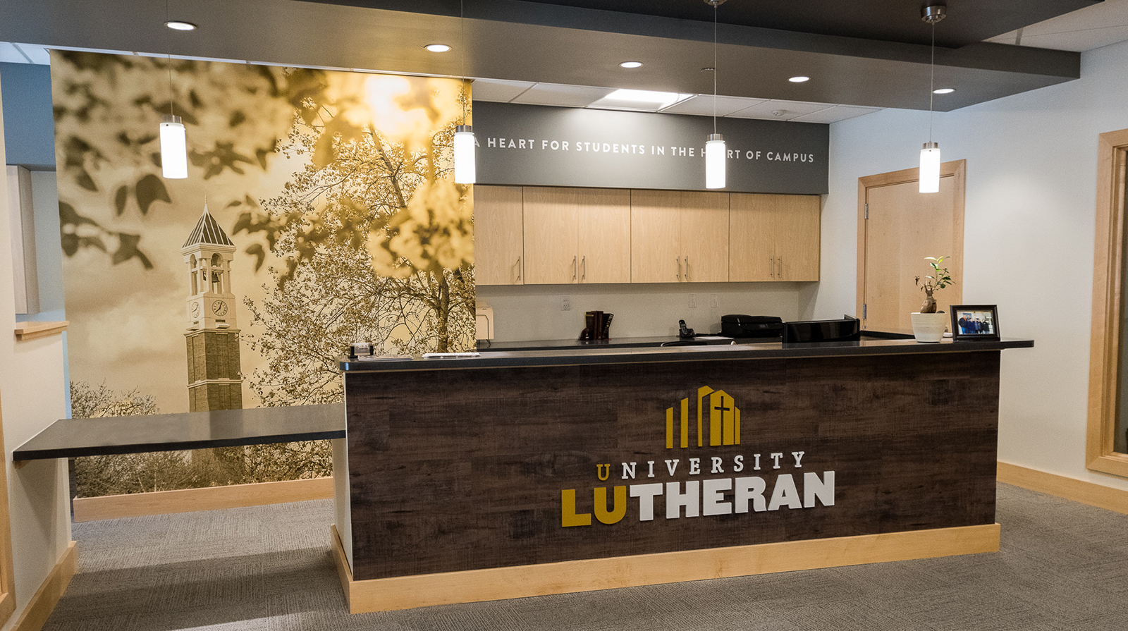 Full Environmental Design by Creativeinc. for University Lutheran Church in West Lafayette, IN. Custom Signage, Interior Signage, Exterior Signage, Wayfinding Signage, ADA Compliant Signage, Wall Wrap, Wall Graphics, Cut Vinyl Graphics, Elevator Graphics, 3D Signage, Frosted Vinyl, Design Services, Installation.